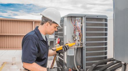 man repairing AC home services
