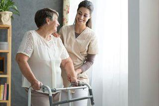 woman providing support and care to old lady