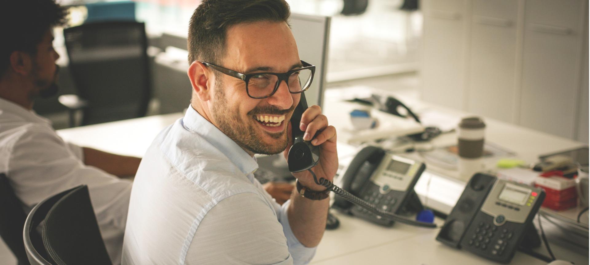 Business man having conversation on landline phone
